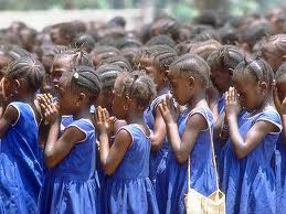 girls praying at schoolimagesCALG2C1K