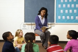 teacher cher-reading-book-to-young-students-in-classroom-horizontally-framed-shot