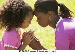 black mother and child prayingmages