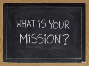 what is your mission question - white chalk handwriting on blackboard